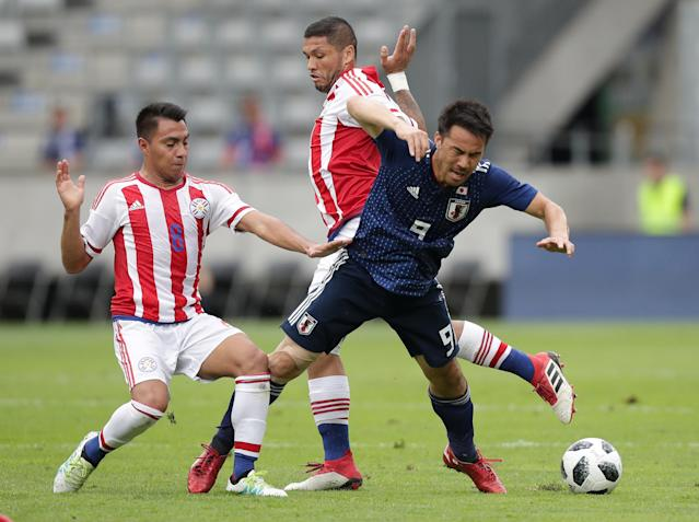 Soccer Football - International Friendly - Japan vs Paraguay - Tivoli-Neu, Innsbruck, Austria - June 12, 2018 Japan's Shinji Okazaki in action with Paraguay's Angel Cardozo REUTERS/Lisi Niesner