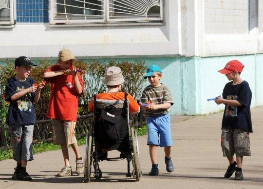 Children play on in an orphanage in Moscow May 12, 2010