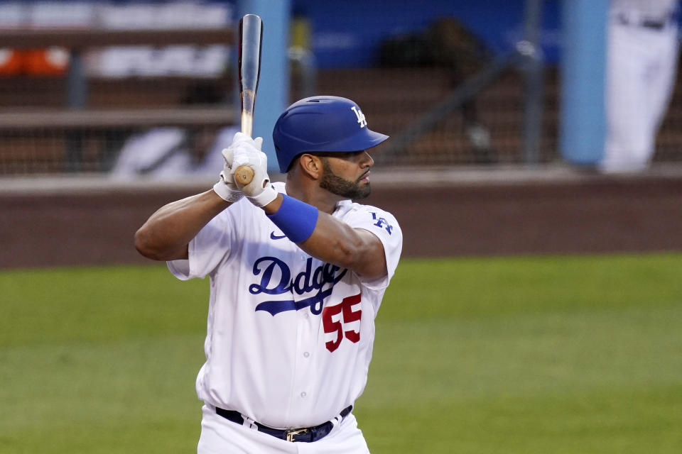 Los Angeles Dodgers' Albert Pujols bats during the first inning of a baseball game against the Arizona Diamondbacks Monday, May 17, 2021, in Los Angeles. (AP Photo/Mark J. Terrill)