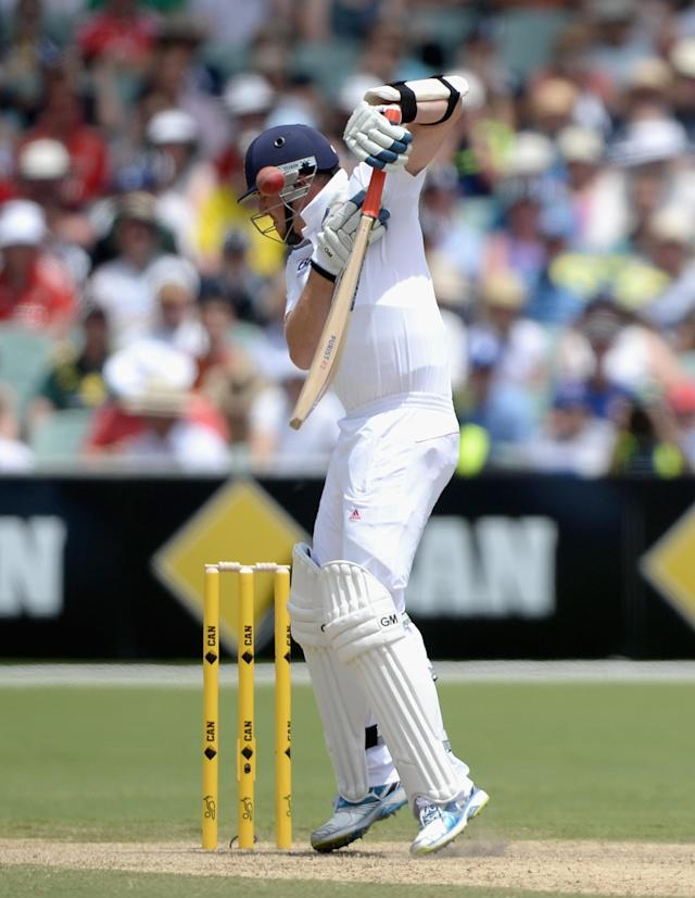 ADELAIDE, AUSTRALIA - DECEMBER 07: Graeme Swann of England receives a short ball from Mitchell Johnson of Australia during day three of the Second Ashes Test match between Australia and England at Adelaide Oval on December 7, 2013 in Adelaide, Australia. (Photo by Gareth Copley/Getty Images)