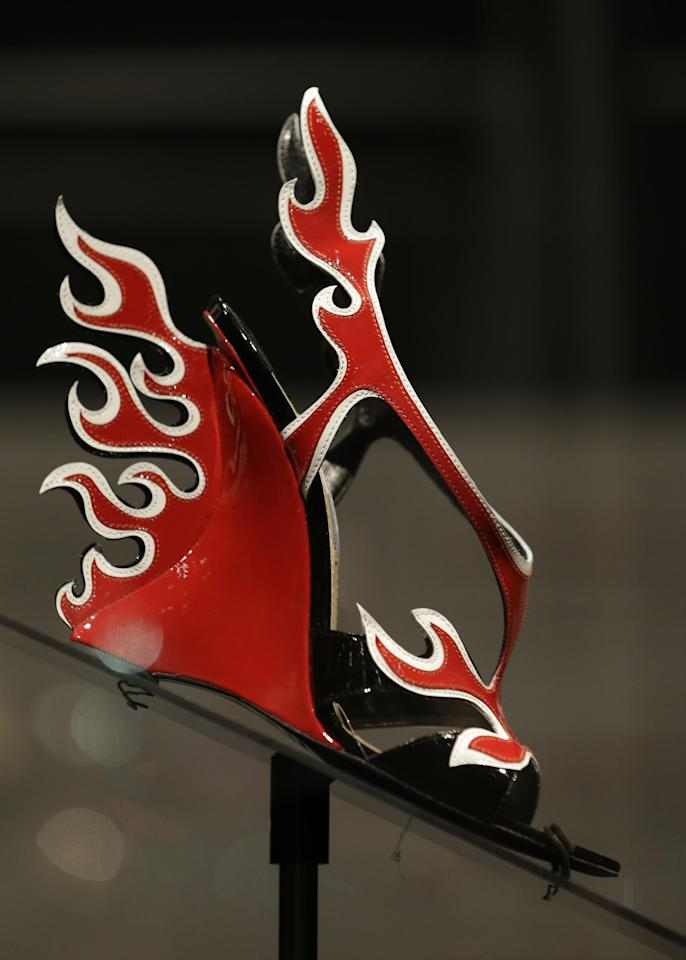 "This Feb. 11, 2013 photo shows a red and white patent leather flame Prada sandal displayed at the ""Shoe Obsession"" exhibit at The Museum at the Fashion Institute of Technology Museum in New York. The exhibition, showing off 153 specimens, runs through April 13. (AP Photo/Kathy Willens)"