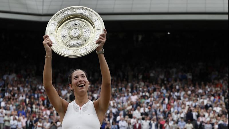 Spain's Garbine Muguruza holds the Wimbledon trophy after defeating Venus Williams