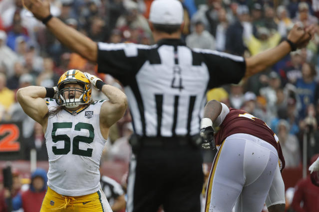 <p>Green Bay Packers linebacker Clay Matthews (52) reacts to his penalty after tackling Washington Redskins quarterback Alex Smith (11) during the second half of an NFL football game, Sunday, Sept. 23, 2018 in Landover, Md. (AP Photo/Alex Brandon) </p>