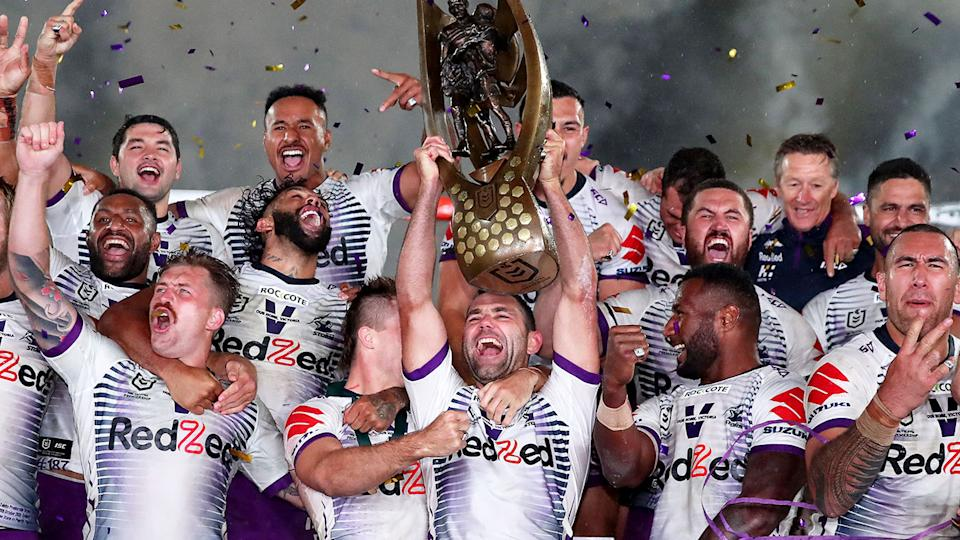 Pictured here, 2020 NRL premiers the Melbourne Storm celebrate with the trophy.