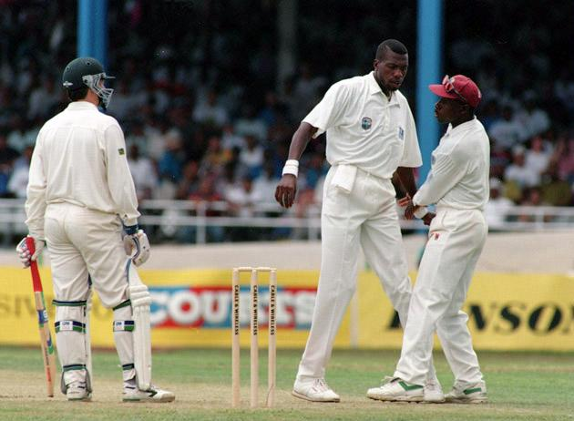 21 APR 1995:  WEST INDIAN BOWLER CURTLY AMBROSE IS HELD BACK BY CAPTAIN RICHIE RICHARDSON AFTER A CONFRONTATION WITH STEVE WAUGH OF AUSTRALIA DURING THE FIRST DAY's PLAY IN THE WEST INDIES V AUSTRALIA THIRD TEST MATCH IN TRINIDAD. Mandatory Credit: Allsport UK/ALLSPORT
