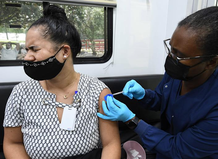 Annie Velez receives a shot of the Pfizer vaccine at a mobile COVID-19 vaccination site. (Paul Hennessy/SOPA Images/LightRocket via Getty Images)