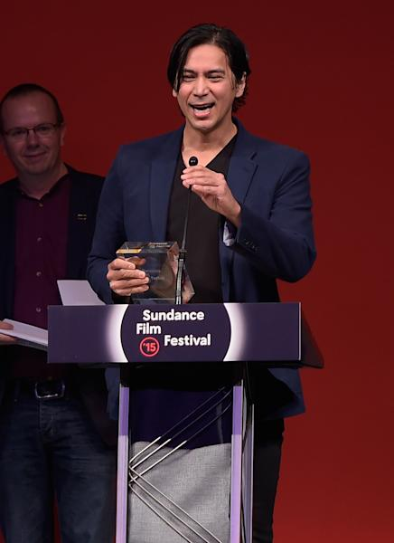 """Kalani Queypo of """"Slow West"""" accepts the World Cinema Grand Jury Prize, on behalf of director John Maclean at the Awards Night Ceremony of the 2015 Sundance Film Festival on January 31, 2015 in Park City, Utah (AFP Photo/Michael Loccisano)"""