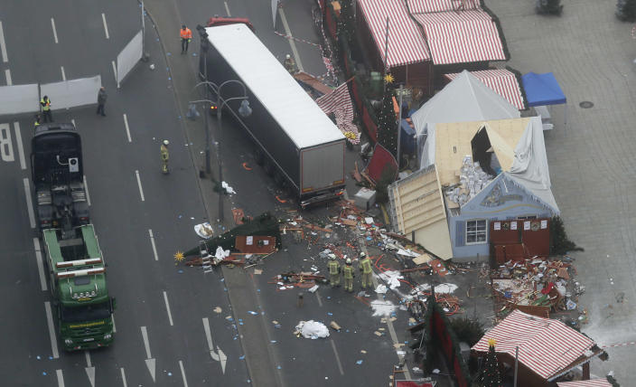 <p>DEC. 20, 2016 — A trail of devastation is left behind in Berlin, Germany the day after a truck ran into a crowded Christmas market and killed several people. (AP Photo/Markus Schreiber) </p>