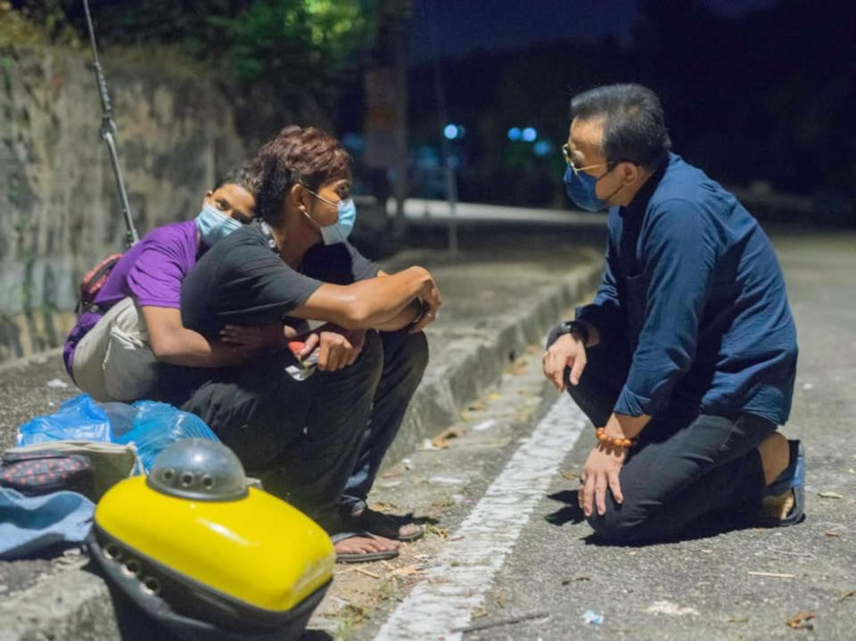 Shah and Siti and their cat were living on the street when Bukit Mertajam MP Steven Sim (right) found out about their situation and helped them. — Picture courtesy of Steven Sim