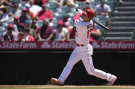 Los Angeles Angels designated hitter Shohei Ohtani (17) hits a home run during the third inning of a baseball game against the Baltimore Orioles Sunday, July 4, 2021, in Anaheim, Calif. (AP Photo/Ashley Landis)