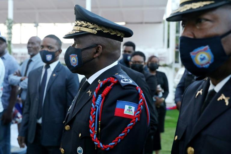 Haiti's national police chief Leon Charles (C) -- seen here at the funeral of Jovenel Moise -- was heckled by locals in Cap-Haitien who believe his force did not do enough to protect Moise