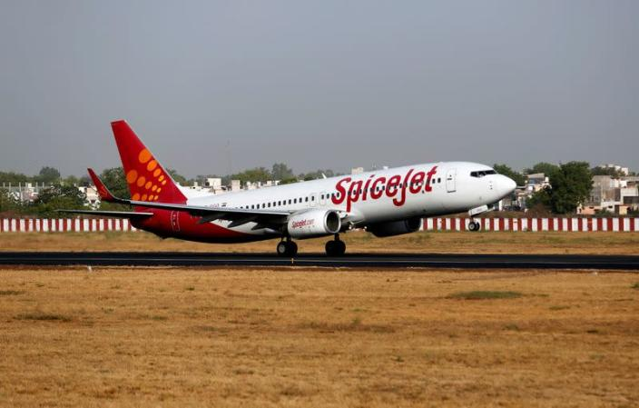 A SpiceJet Boeing 737 passenger aircraft takes off from Sardar Vallabhbhai Patel international airport in Ahmedabad