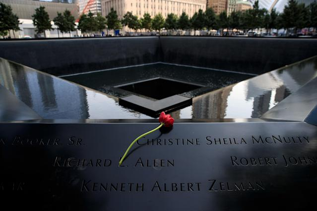 <p>A flower is left at the North pool during a commemoration ceremony for the victims of the September 11 terrorist attacks at the National September 11 Memorial, September 11, 2017 in New York City. In New York City and throughout the United States, the country is marking the 16th anniversary of the September 11 terrorist attacks. (Photo: Drew Angerer/Getty Images) </p>