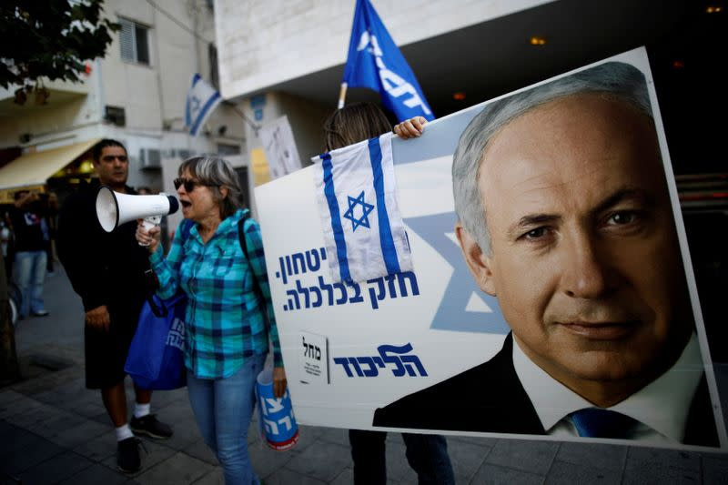 FILE PHOTO:  Supporters of Israeli Prime Minister Benjamin Netanyahu protest outside Likud Party headquarters in Tel Aviv