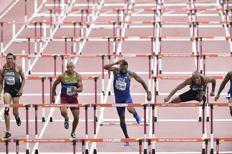 Athletes, from left, Pierce Lepage, of Canada, Georni Jaramillo, of Venezuela, Devon Williams, of the United States, and Damian Warner, of Canada, race in the men's decathlon 110 meter hurdles, at the World Athletics Championships in Doha, Qatar, Thursday, Oct. 3, 2019. (AP Photo/Martin Meissner)
