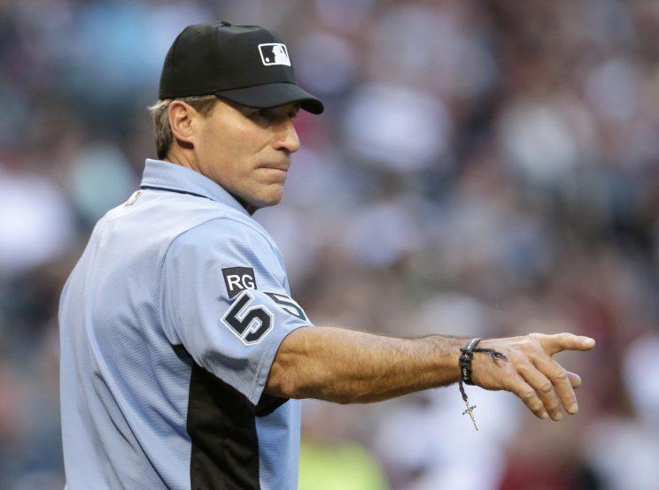 Umpire Angel Hernandez is suing commissioner Rob Manfred and MLB. (AP Photo)