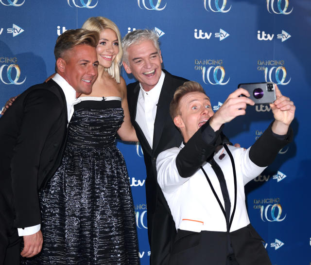 Matt Evers, Holly Willoughby, Phillip Schofield and Ian Watkins during the Dancing On Ice 2019 photocall at the Dancing On Ice Studio, ITV Studios, Old Bovingdon Airfield on December 09, 2019 in Bovingdon, England. (Photo by Karwai Tang/WireImage)