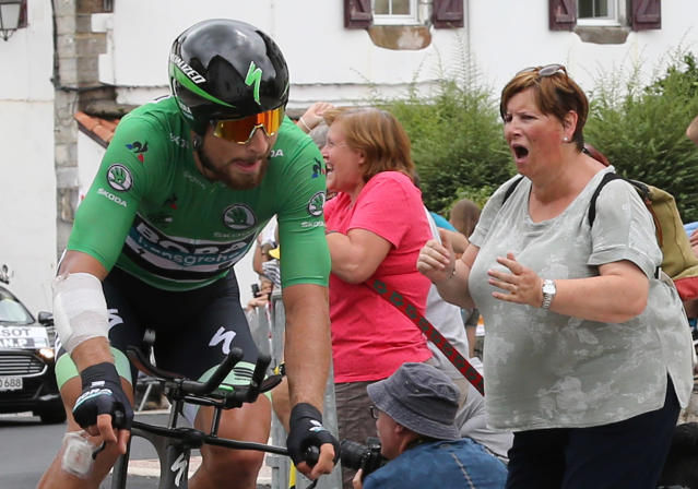 A spectator cheers Slovakia's Peter Sagan as he rides during the twentieth stage of the Tour de France cycling race, an individual time trial over 31 kilometers (19.3 miles) with start in Saint-Pee-sur-Nivelle and finish in Espelette, France, Saturday, July 28, 2018. (AP Photo/Bob Edme)