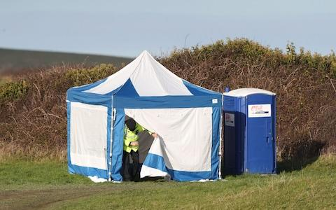 Police activity on a costal path near Swanage, Dorset, as a body was discovered in the hunt for the missing 19-year-old Gaia Pope - Credit: Andrew Matthews/PA