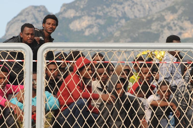"Migrants wait to disembark from the Naval ship ""Bettica"" following a rescue operation at sea on May 5, 2015 in the port of Salerno, southern Italy (AFP Photo/Mario Laporta)"