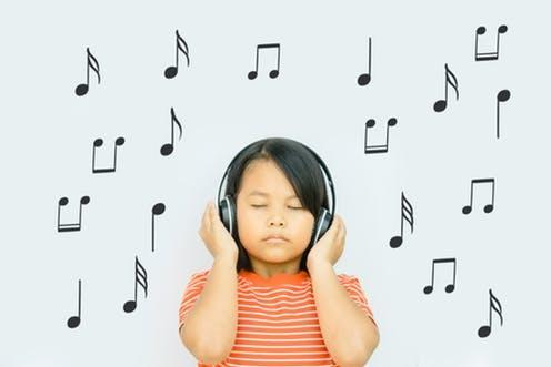 """<span class=""""caption"""">Tuning in.</span> <span class=""""attribution""""><a class=""""link rapid-noclick-resp"""" href=""""https://www.shutterstock.com/image-photo/happy-smiling-child-enjoys-listens-music-1344479351?src=oV3oG49qq35yv5J_HdtLNg-1-98"""" rel=""""nofollow noopener"""" target=""""_blank"""" data-ylk=""""slk:Shutterstock/MIA Studio"""">Shutterstock/MIA Studio</a></span>"""