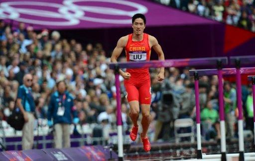 China's Liu Xiang hops off the track after falling during the men's 110m hurdles heats