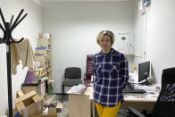 """Tatsiana Hatsura-Yavorska, who leads a rights group that helps those released from prison adapt to life, poses for a photo after a police search in Minsk, Belarus, Friday, April 23, 2021. She was arrested in Belarus on charges of """"organizing actions that violate public order,"""" jailed for 10 days, and cannot leave the country. She faces charges that could land her in prison for three years. (AP Photo)"""