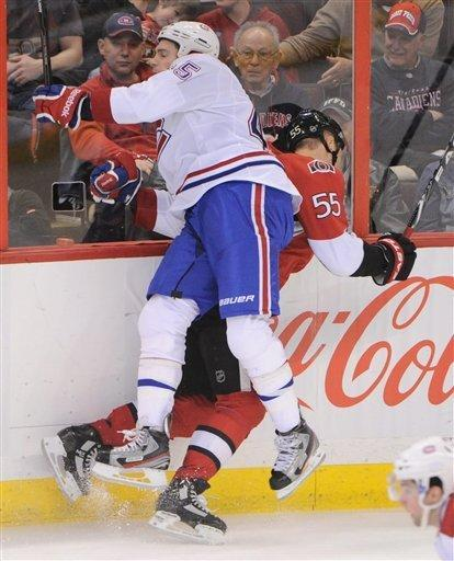 CORRECTS YEAR - Ottawa Senators' Sergei Gonchar and Montreal Canadiens' Mike Blunden collide during NHL hockey action at the Scotiabank Place in Ottawa, Ontario, on Friday, March 16, 2012. (AP Photo/The Canadian Press, Sean Kilpatrick)