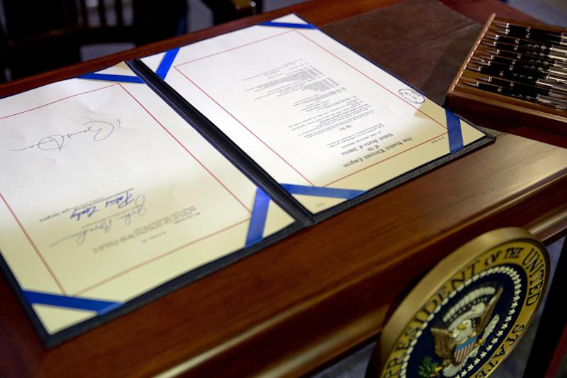 The farm bill signed by President Barack Obama is seen at Michigan State University, in East Lansing, Mich., on Friday, Feb. 7, 2014. (AP Photo/Jacquelyn Martin)