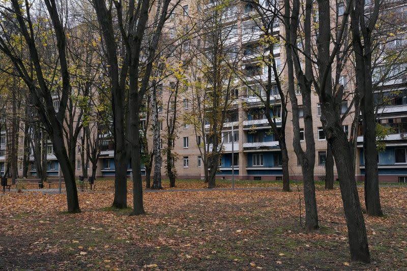 Soviet-era concrete apartment blocks are seen behind trees in Star City near Moscow