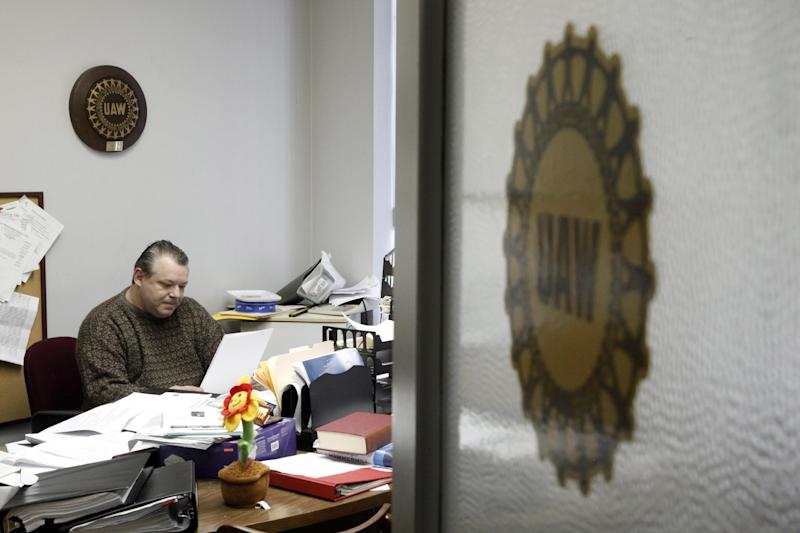 """United Auto Workers Local 174 President John Zimmick works in his office in Romulus, Mich. on Friday March 22, 2013. Zimmick worries not just about his local - but the fate of all unions. """"It weighs on me every single night before I go to bed,"""" he says. """"Unions don't have the leverage and power that we used to. It doesn't mean we won't regain it. The unions, in my opinion, will come roaring back. .... But the image is terrible right now. The media spins us as hurting business and the non-union workers — there's animosity and jealousy toward us."""" (AP Photo/Paul Sancya)"""