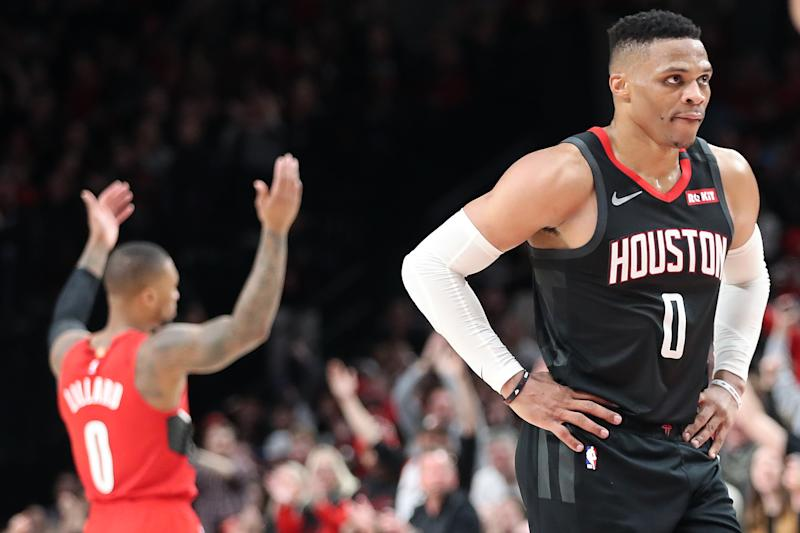 Damian Lillard and Russell Westbrook have a longstanding on-court feud. (Abbie Parr/Getty Images)