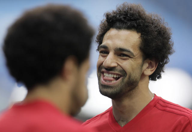 Egypt's Mohamed Salah, right, smiles during Egypt's official training on the eve of the group A match between Russia and Egypt at the 2018 soccer World Cup in the St. Petersburg stadium in St. Petersburg, Russia, Monday, June 18, 2018. (AP Photo/Dmitri Lovetsky)