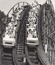 """<p><a href=""""https://www.kennywood.com/attractions"""" rel=""""nofollow noopener"""" target=""""_blank"""" data-ylk=""""slk:Kennywood's"""" class=""""link rapid-noclick-resp"""">Kennywood's</a> historic Racer does a neat trick: Two trains start off at the same time, and, when they return, they've switched platform sides (without somehow colliding mid-course, and staying neck-and-neck throughout). How? The trains are actually on one, continuous track — called a möbius loop roller coaster — and it's the only one in the United States still in use today.</p>"""