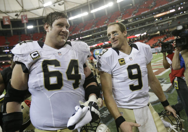 FILE - In this Jan. 3, 2016, file photo, New Orleans Saints quarterback Drew Brees (9) walks off the field with New Orleans Saints tackle Zach Strief (64) after the second half of an NFL football game against the Atlanta Falcons, in Atlanta. Strief says hes retiring after 12 NFL seasons. Strief, who made a tearful announcement on Monday, March 12, 2018, in Metairie, La., says his career far exceeded his expectations. (AP Photo/David Goldman, File)