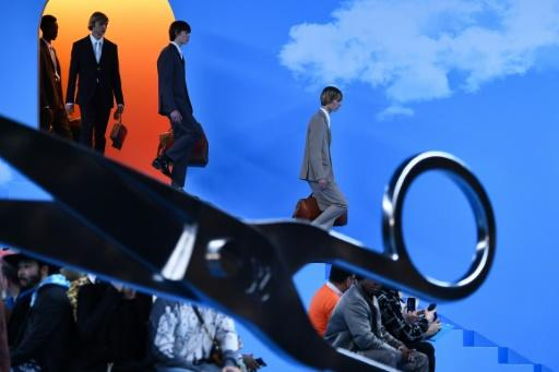Stairway from heaven: Models in suits at the Louis Vuitton Paris men's fashion week show