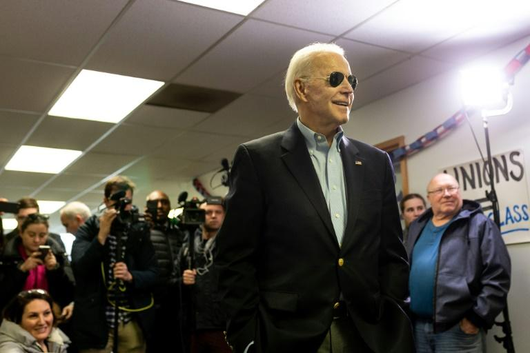 On his Snapchat profile, former vice president Joe Biden (pictured February 2020) keeps it cool: he is shown without a tie but with his signature aviator sunglasses, which followers can try on using a custom campaign filter (AFP Photo/Kerem Yucel)