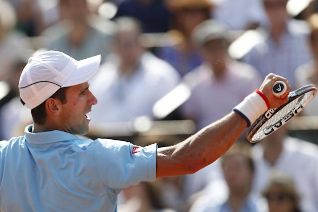 Serbia's Novak Djokovic returns the ball during the final of the French Open tennis tournament against Spain's Rafael Nadal at the Roland Garros stadium, in Paris, France, Sunday, June 8, 2014. (AP Photo/Darko Vojinovic)