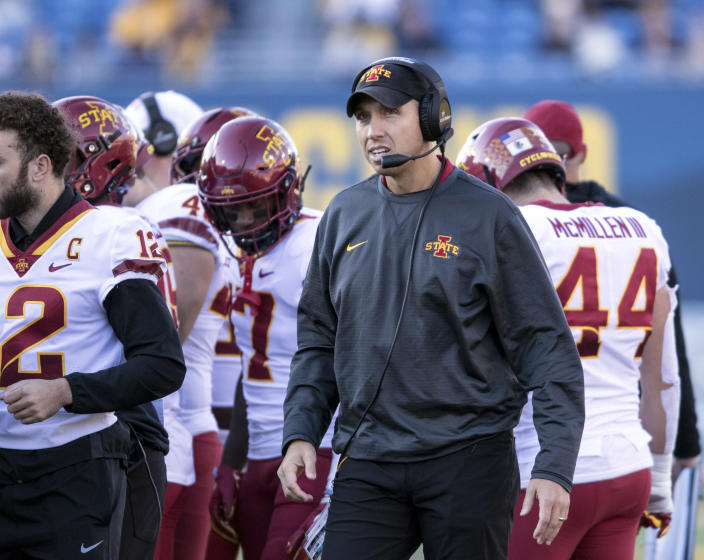 Iowa State head coach Matt Campbell surveys the field during the first half of an NCAA college football game against West Virginia, Saturday, Oct. 12, 2019, in Morgantown, W.Va. (AP Photo/Raymond Thompson)
