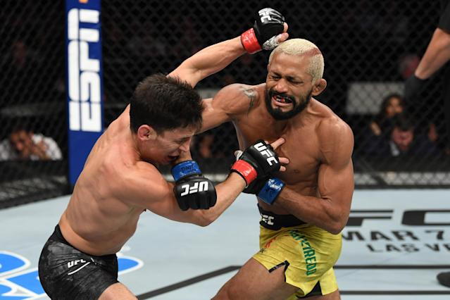 Deiveson Figueiredo (R) punches Joseph Benavidez on February 29 in Norfolk, Virginia. They will rematch on July 18 in Abu Dhabi for the UFC flyweight championship. (Photo by Josh Hedges/Getty Images)