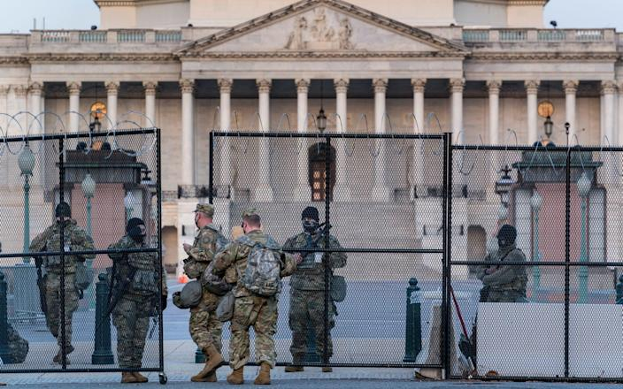 National Guard troops keep watch at the Capitol in Washington - AP Photo/J. Scott Applewhite