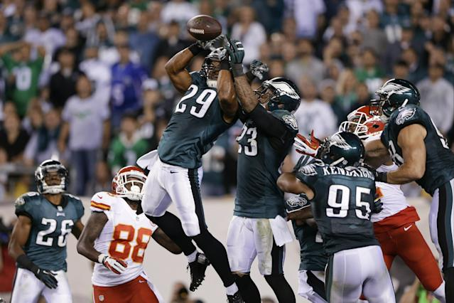 Philadelphia Eagles' Nate Allen (29) and Patrick Chung (23) break up a Kansas City Chiefs pass in the end zone during the first half of an NFL football game, Thursday, Sept. 19, 2013, in Philadelphia. (AP Photo/Matt Rourke)
