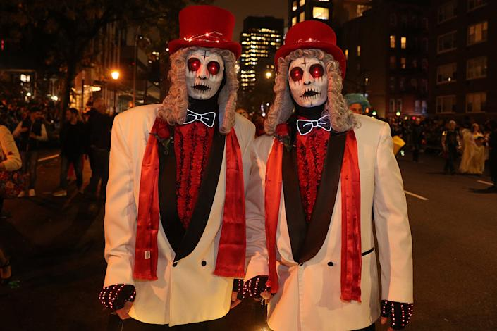 Two revelers dressed as zombies with top hats and tuxedos march in the Halloween Parade in New York City. (Photo: Gordon Donovan/Yahoo News)