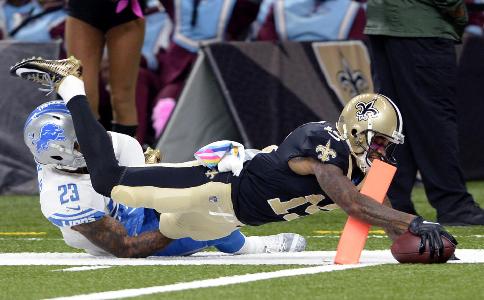 <p>New Orleans Saints wide receiver Ted Ginn (19) breaks past Detroit Lions cornerback Darius Slay on a touchdown reception in the first half of an NFL football game in New Orleans, Sunday, Oct. 15, 2017. (AP Photo/Bill Feig) </p>
