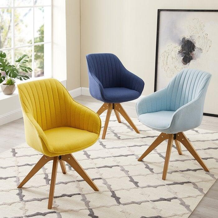 """<h2>Corrigan Studio Brister Swivel Side Chair</h2><br><strong>Best For: Anti-Wheelers</strong><br>Not all desk chairs come tricked out with wheels. If you're looking for a stationary piece that will blend from office to living room, then this incognito swivel style is here to support you. <br><br><strong>The Hype: </strong>4.6 out of 5 stars and 521 reviews on <a href=""""https://www.wayfair.com/furniture/pdp/corrigan-studio-brister-swivel-side-chair-w001809980.html"""" rel=""""nofollow noopener"""" target=""""_blank"""" data-ylk=""""slk:Wayfair"""" class=""""link rapid-noclick-resp"""">Wayfair</a><br><br><strong>Comfy Butts Say:</strong> """"Now that I'm working from home full time, I needed a chair that provided me with better back support. I'm so glad I did! It provides me with the back support that I need. I also like the fact that it swivels. I'm 5'9 female and found the chair comfortable, too.""""<br><br><strong>Corrigan Studio</strong> Brister Swivel Side Chair, $, available at <a href=""""https://go.skimresources.com/?id=30283X879131&url=https%3A%2F%2Fwww.wayfair.com%2Ffurniture%2Fpdp%2Fcorrigan-studio-brister-swivel-side-chair-w001809980.html"""" rel=""""nofollow noopener"""" target=""""_blank"""" data-ylk=""""slk:Wayfair"""" class=""""link rapid-noclick-resp"""">Wayfair</a>"""