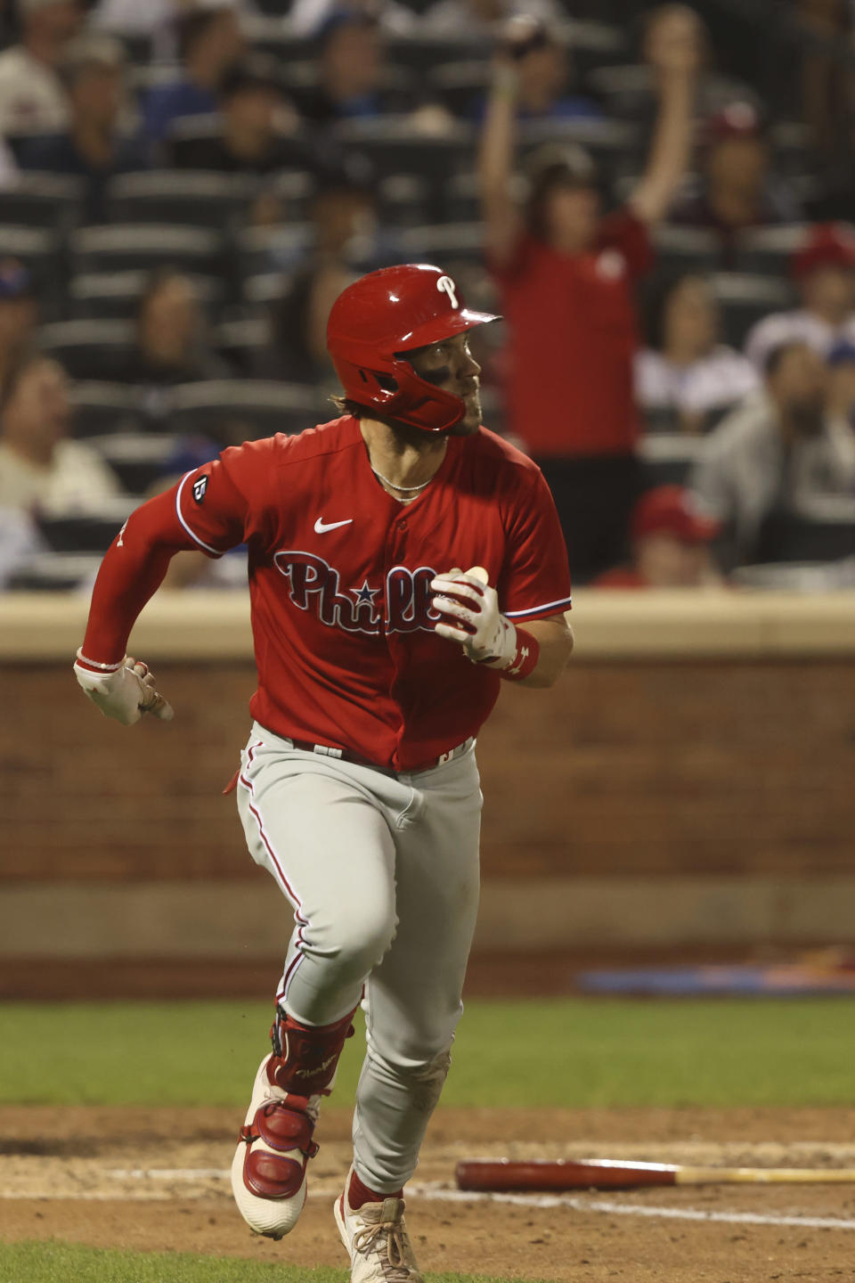 Philadelphia Phillies' Bryce Harper runs after hitting a sacrifice fly during the fifth inning of a baseball game against the New York Mets, Sunday, Sept. 19, 2021, in New York. (AP Photo/Jason DeCrow)