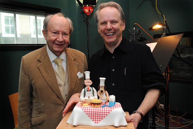 Peter Sallis (left) is presented with a suprise birthday cake, by Wallace & Gromit creator Nick Park, on the occasion of his 87th birthday, whilst in the studio recording for the forthcoming Wallace & Gromit TV special 'A Matter of Loaf & Death', (TX: TBC Christmas 2008) at The Sound Company, in London.