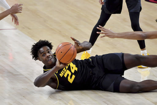 Missouri forward Kobe Brown (24) tries to pass the ball against Arkansas during the first half of an NCAA college basketball game in Fayetteville, Ark. Saturday, Jan. 2, 2021. (AP Photo/Michael Woods)