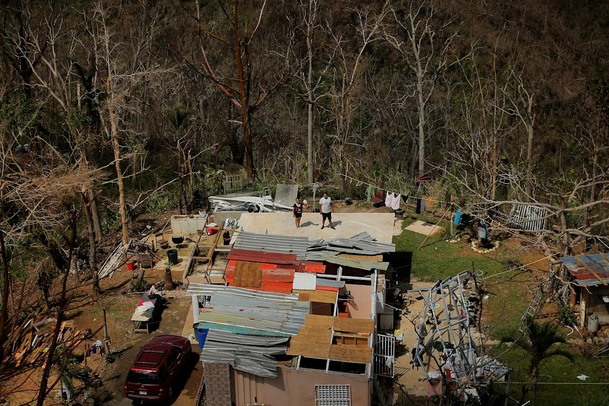 Residents signal to helicopters that they need water during recovery efforts following Hurricane Maria, near Ciales, Puerto Rico, on Oct. 7, 2017. (Photo: Lucas Jackson/Reuters)