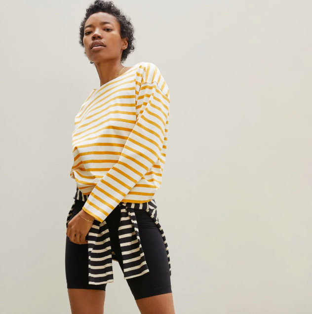 The Modern Breton Tee in Off-White / Sunrise. Image via Everlane.